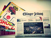 Beilagen in Zeitungen einstecken