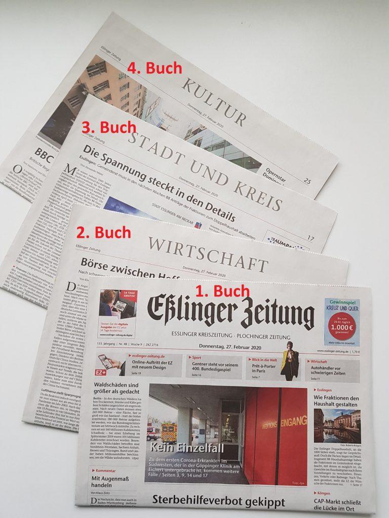 Zeitung mit sichtbarer Buchstruktur und ineinanderliegenden einzelnen Büchern